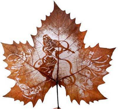 Картины вырезанные на листьях - 2