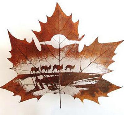 Картины вырезанные на листьях - 7